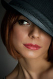portrait of attractive elegant sexy woman with black hat