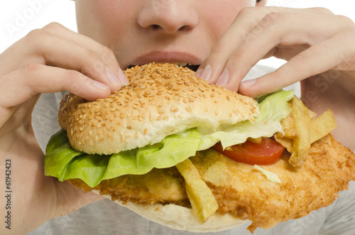 Close up of a man eating hamburger, fast food unhealthy burger
