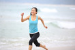 fitness woman running at beach