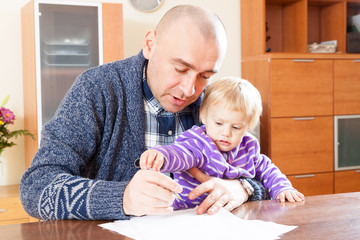 Father working  with daughter