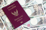 Thailand passport on the Japanese banknotes