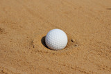 Golf ball  on sand in bunker