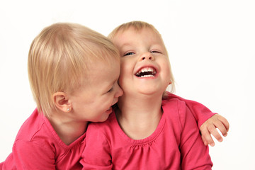Little twin girls laughing