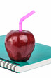 red apple on a book isolated