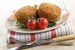 fresh fried trout fishcake on a plate