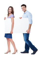 Man and woman carrying a placard