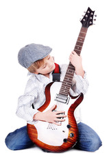 Young musician with a guitar on a white background
