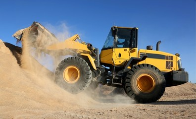 Front End Loading Digging in Sand