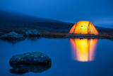 Illuminated tent in the blue hour