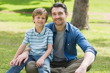 Portrait of a father and boy at park