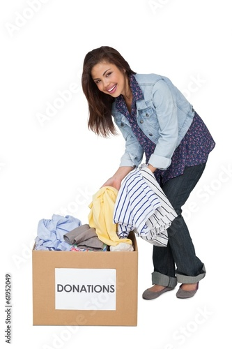 Portrait of a happy young woman with clothes donation
