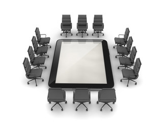 Office chairs around the tablet computer