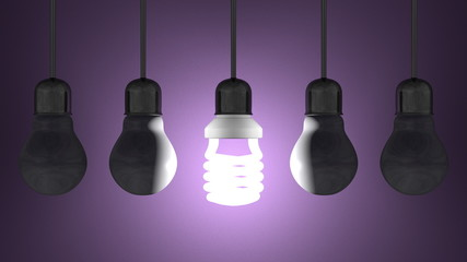 Glowing spiral light bulb, dead tungsten ones hanging on violet
