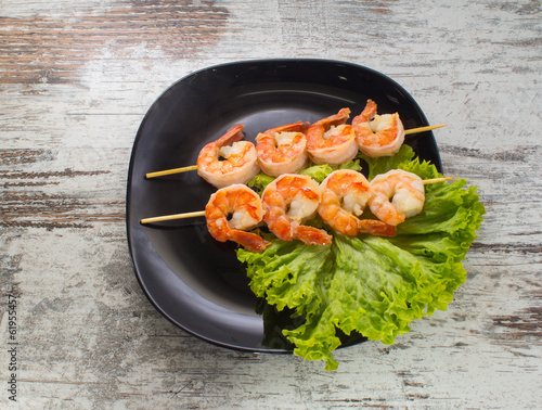Shrimp shashlik on a binrage background