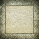 Paper sheet in picture frame on grunge background