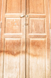 Close old wooden door .