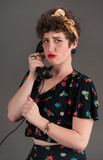 Pinup Girl in Flowered Outfit Pouts on the Phone