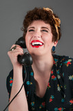 Pinup Girl in Flowered Outfit Laughs on the Phone