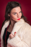 Pinup Girl Poses in Creamy Fur Coat