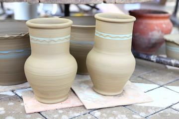 raw clay pots at the fair