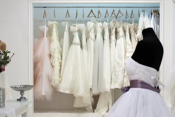Wedding dresses on hangers in the showroom
