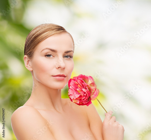 lovely woman with peonie flower