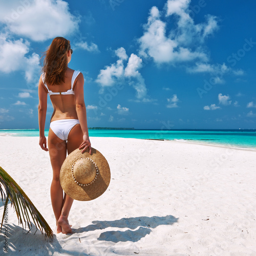 Woman in bikini on a beach at Maldives