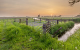 Orange Sunset over Polder Landscape