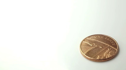 UK One Penny Coin spinning until it drops