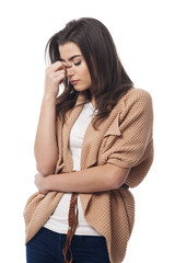 Worried young woman with sinusitis