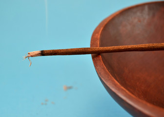 Incense sticks on blue background