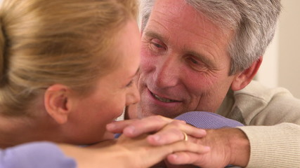 Close-up of mature couple talking