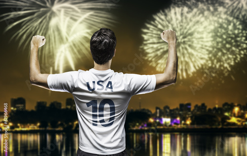 American soccer fan celebrates the victory after the match