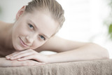 closeup of a beautiful young woman lying on a massage table