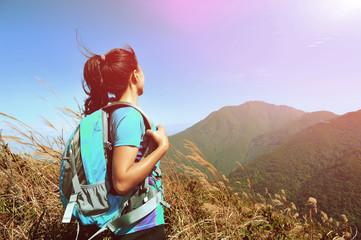woman hiker enjoy the view at mountain peak