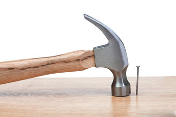 Hammer hitting a nail into a wood