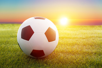 soccer ball on the field with sunset