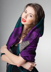 pretty woman wearing scarf -studio shot on grey background