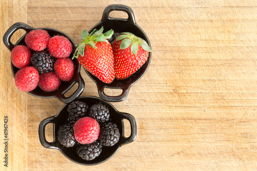 Ramekins of healthy ripe fresh mixed berries