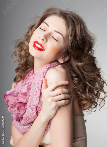 pretty woman wearing scarf -studio shot on grey background