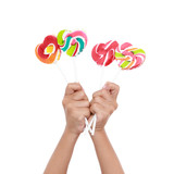 Colorful lollipop on children hand  isolated on the white