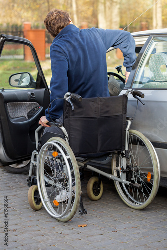 Disabled man getting in the car