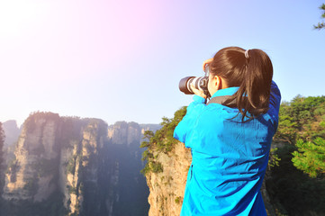 woman photographer taking photo at zhangjiajie