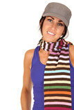 pretty female wearing hat and multi-colored striped scarf