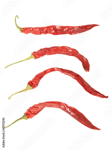Set of Withered red peppers. Isolated on white. High definition