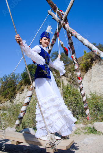 Kazakh young woman playing outdoor