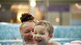 Grandmother and a grandson in the swimming pool