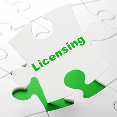 Law concept: Licensing on puzzle background