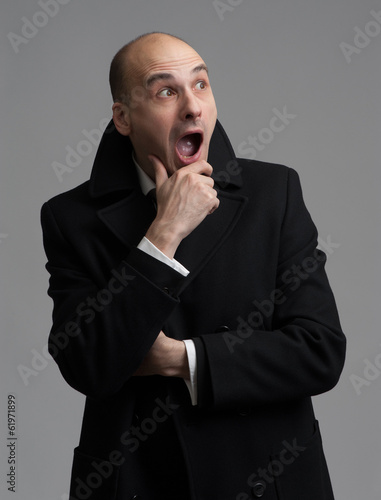 shocked man wearing overcoat