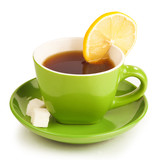 cup of tea with lemon and sugar cubes